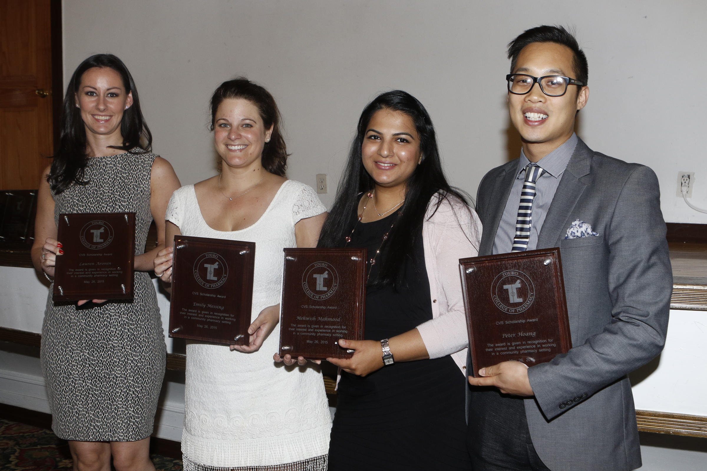 Frpm L-R: Lauren Aronin, Emily Messing, Mehwish Mahmood and Peter Hoang pose with their CVS Scholarship Awards.