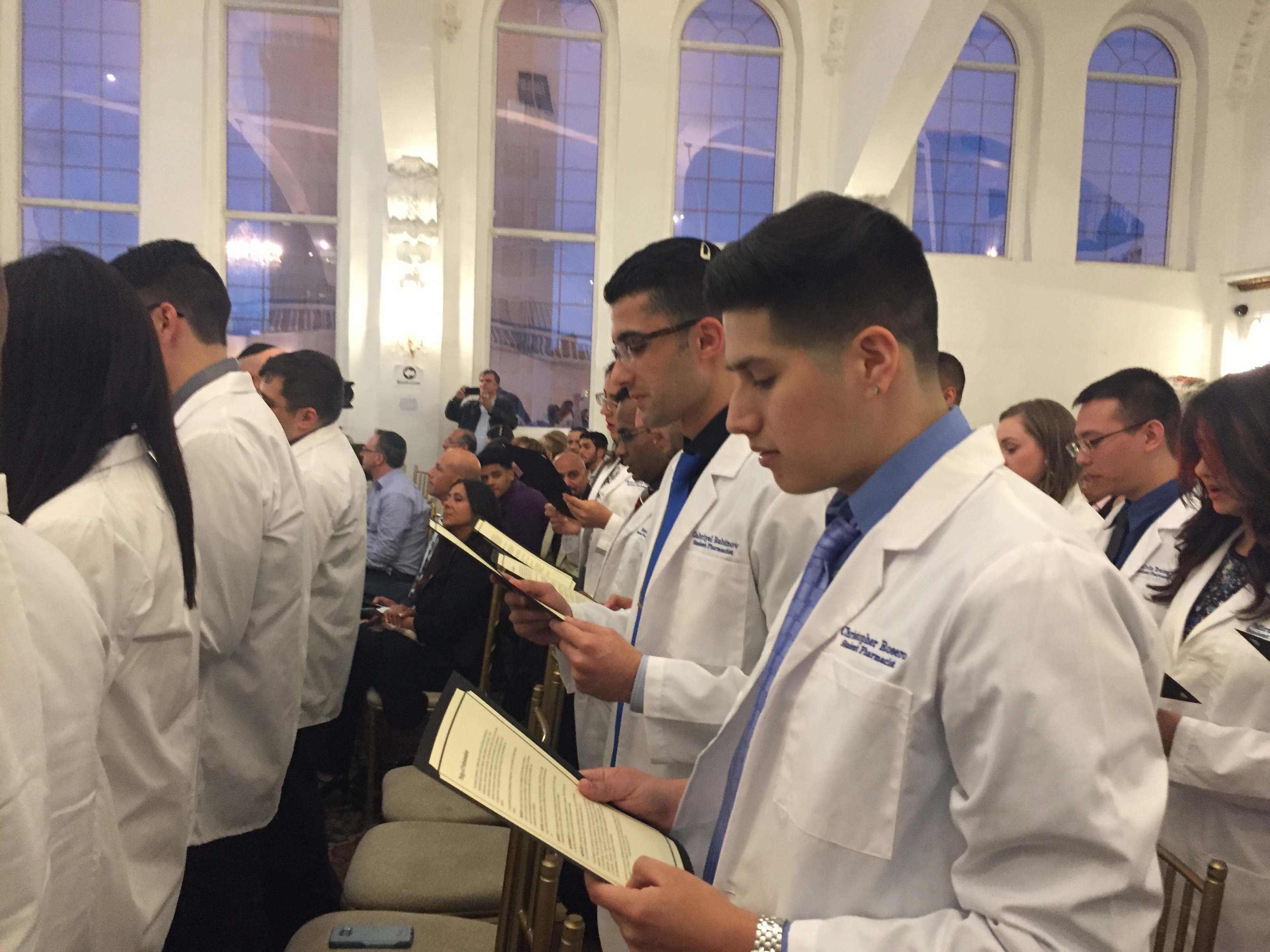 Members of Touro College of Pharmacy Class of 2020 recite the Oath of a Pharmacist during their White Coat Ceremony at the Al Hambra Ballroom in Harlem on Sept. 29.