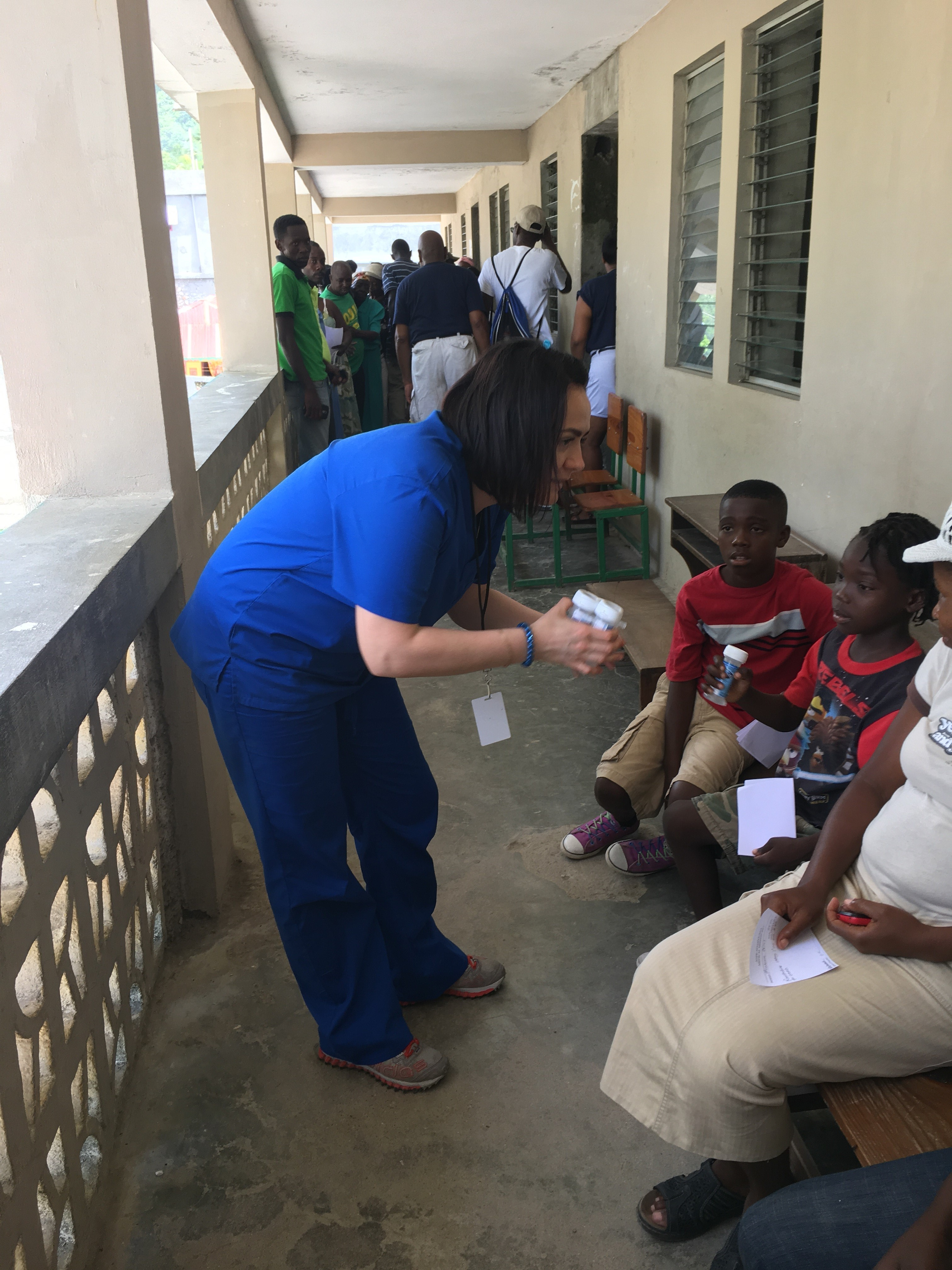 P4 Olga Rashchupkina gives children Pedialyte in Haiti.